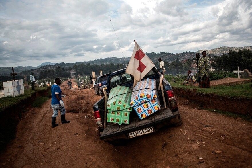 Coffins containing the bodies of two people who died of Ebola are brought to a cemetery in Butembo for burial on May 16. The case count in the 10-month-long outbreak topped 2,000 this week.