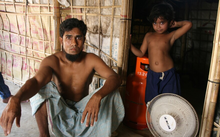 Hamid Hassin, sitting in his shelter in the Balukali refugee camp, says he has no desire to move to a new island camp being built for the Rohingya refugees.