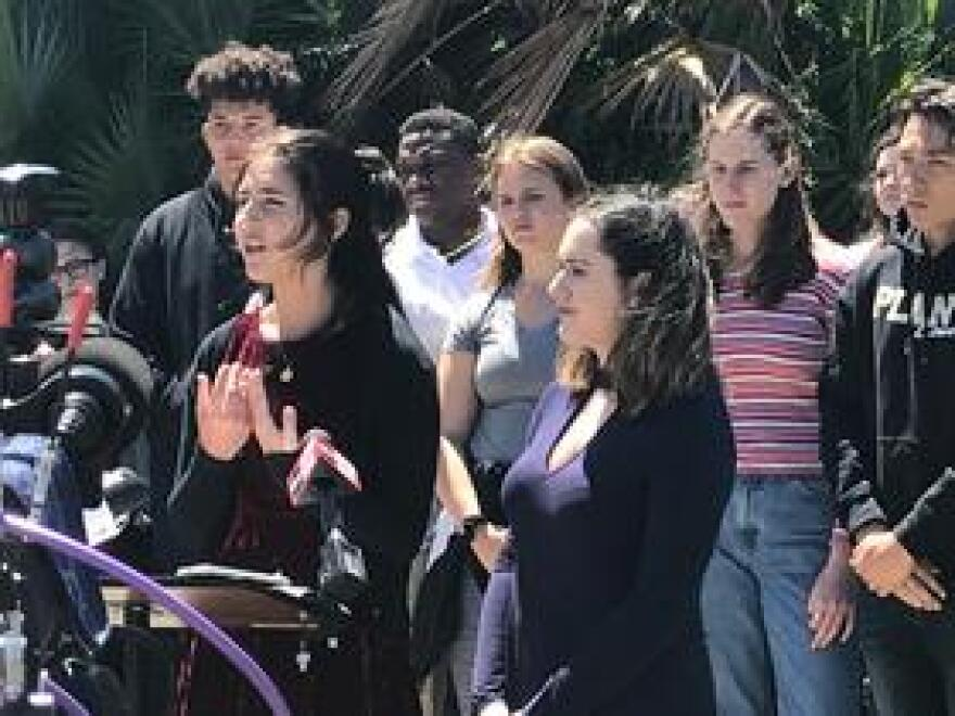 """Plant High School students Brooke Shapiro (left) and Macie Lavender address reporters to promote Saturday's """"March For Our Lives"""" demonstration."""
