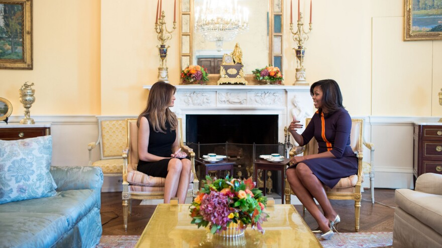 First Lady Michelle Obama meets with Melania Trump for tea in the Yellow Oval Room of the White House on Thursday.