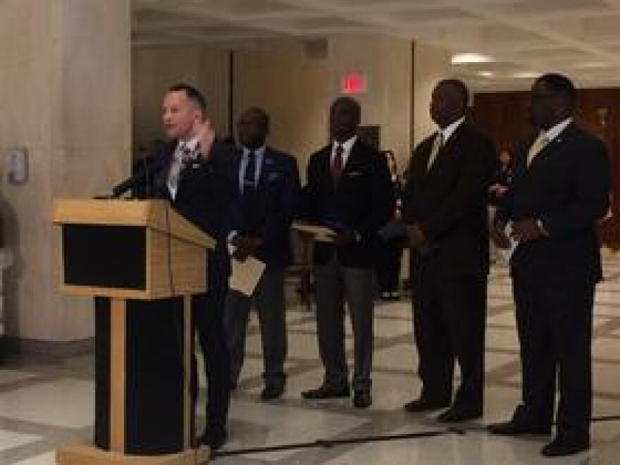 Joined by other Florida House Democrats, Rep. Carlos Guillermo Smith (D-Orlando) speaks at a press conference on higher education and House Bill 7055.