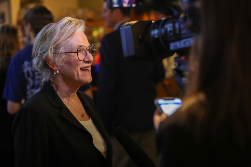 District Attorney Margaret Moore talks with supporters at Shoal Creek Saloon on election night.