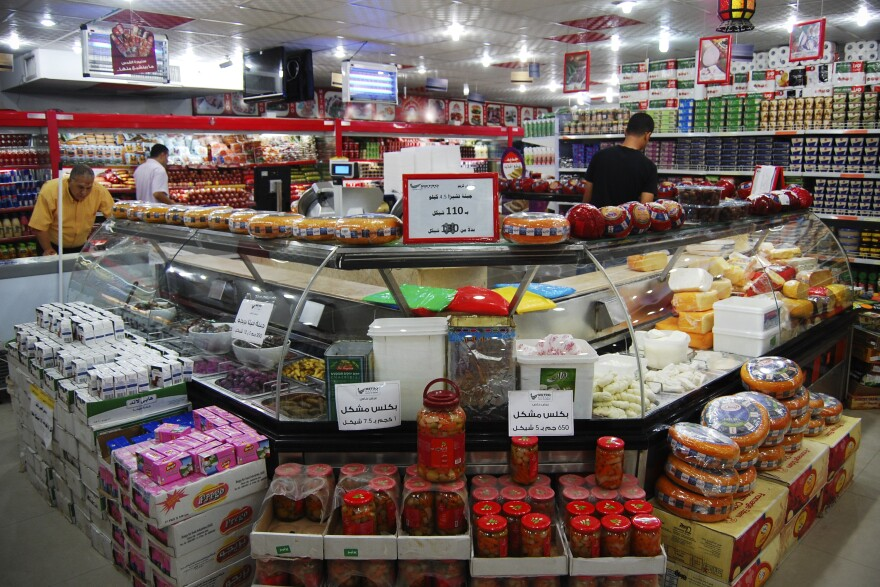 The cheese counter at an upscale supermarket in Gaza City. Although the Egyptian military's crackdown on trade through smuggling tunnels has significantly affected construction and transportation workers, the U.N. says there's no humanitarian crisis. Many consumer goods are allowed in via Israel.