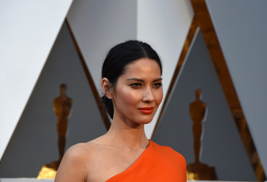 Actress Olivia Munn arrives on the red carpet for the Oscars on Feb. 28. Munn has spoken about being connected to multiple parts of East Asia.