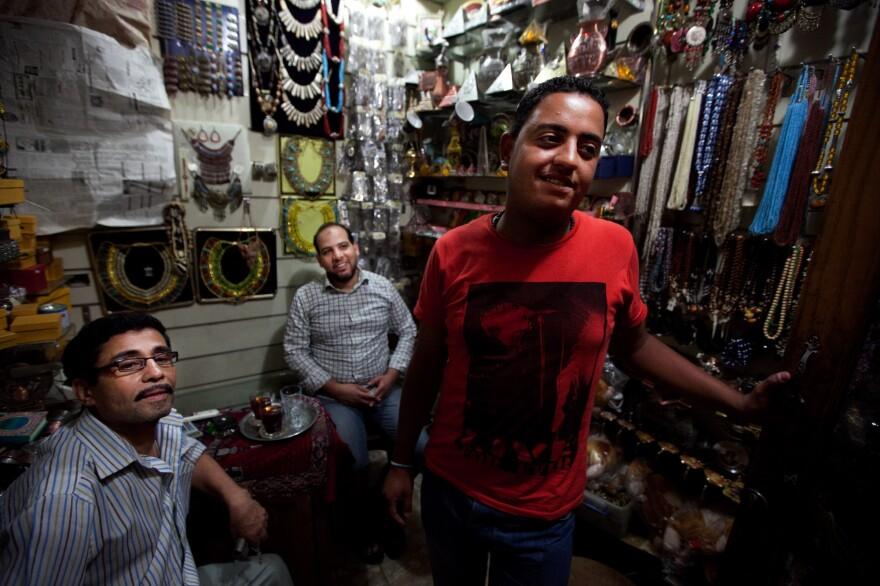 Scenes from the Khan el-Khalili market in downtown Cairo. Karim Gomma (right), a shop worker, says he's voting for the Muslim Brotherhood candidate, Mohammed Mursi. But he says most shop owners are voting for Ahmed Shafiq because he has promised to restore law and order.