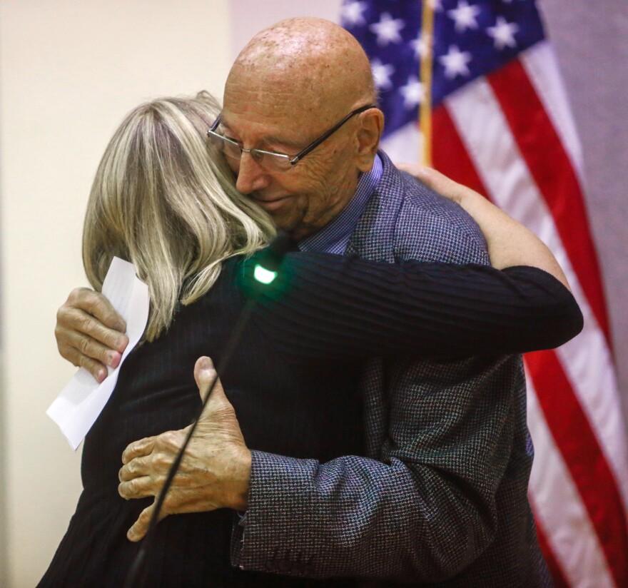 Barbara Petersen hugs Pete Weitzel