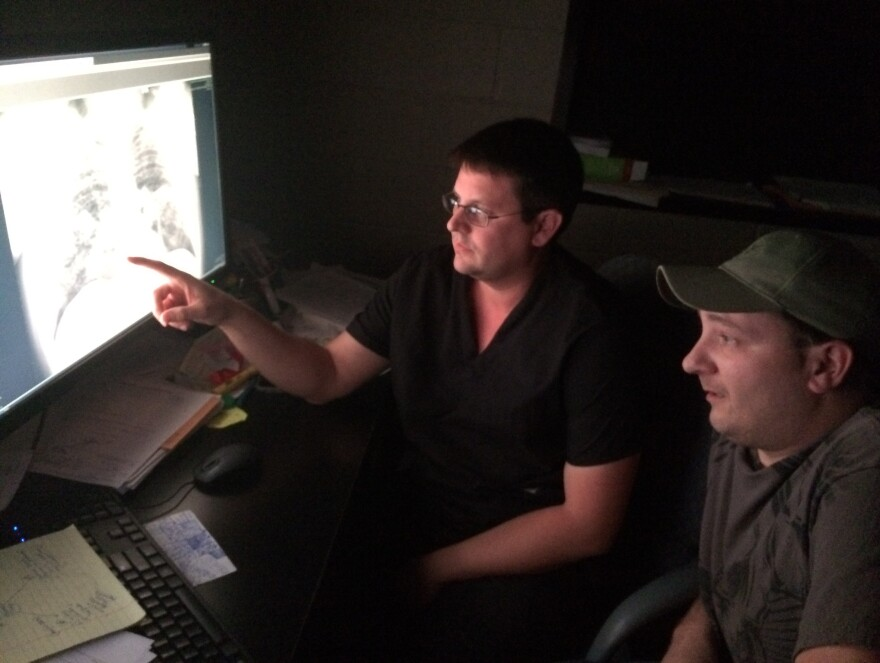 Radiologist Dr. Brandon Crum reviews an X-ray of the lungs of Mackie Branham, who suffers from advanced black lung disease. Dr. Crum is among the Kentucky radiologists now barred from assessing X-rays in state workers' compensation cases filed by coal miners seeking black lung benefits.