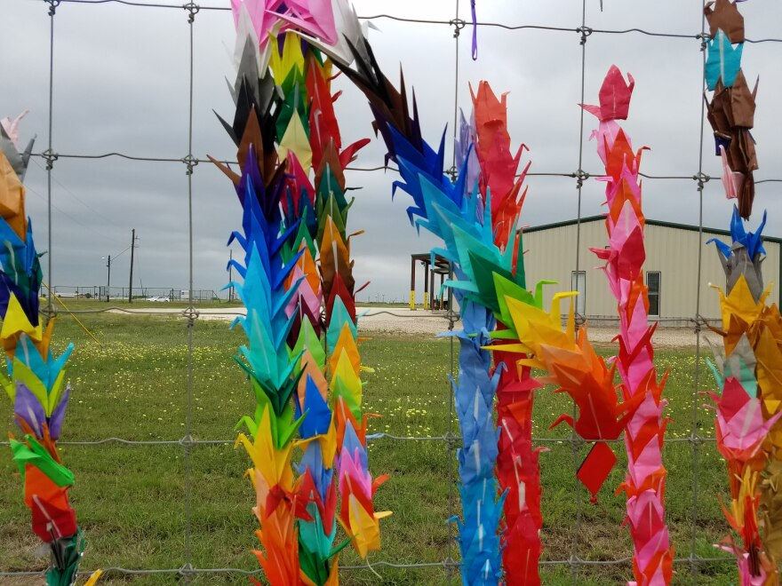Origami cranes hang on a fence outside the South Texas family detention center in Dilley, Texas March 30, 2019.