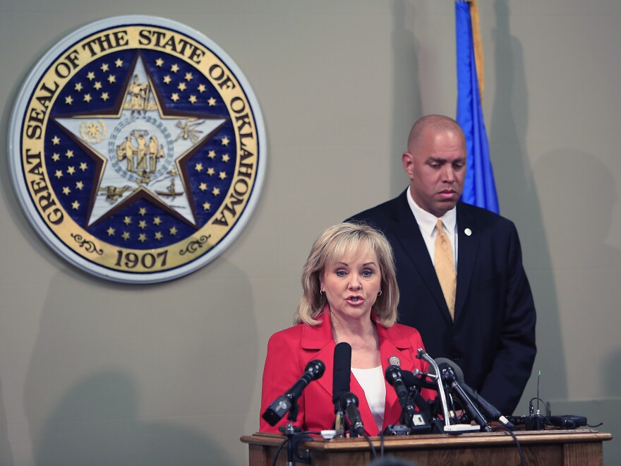 Oklahoma Gov. Mary Fallin issues a statement to the media after the execution of Clayton Lockett. Oklahoma Secretary of Safety and Security Michael C. Thompson stands behind her at the Oklahoma State Capitol in Oklahoma City.