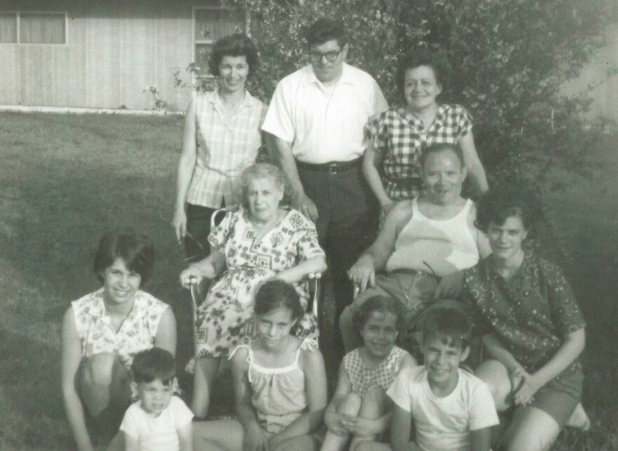 Howard Berkes (seated, front row right) volunteered to be part of a COVID-19 research study this year. He says his family, photographed here in the 1960s, had a history of stepping up during difficult times. That includes his grandparents (in middle), who fled the pogroms of Eastern Europe in the 1920s to raise a family in the United States.