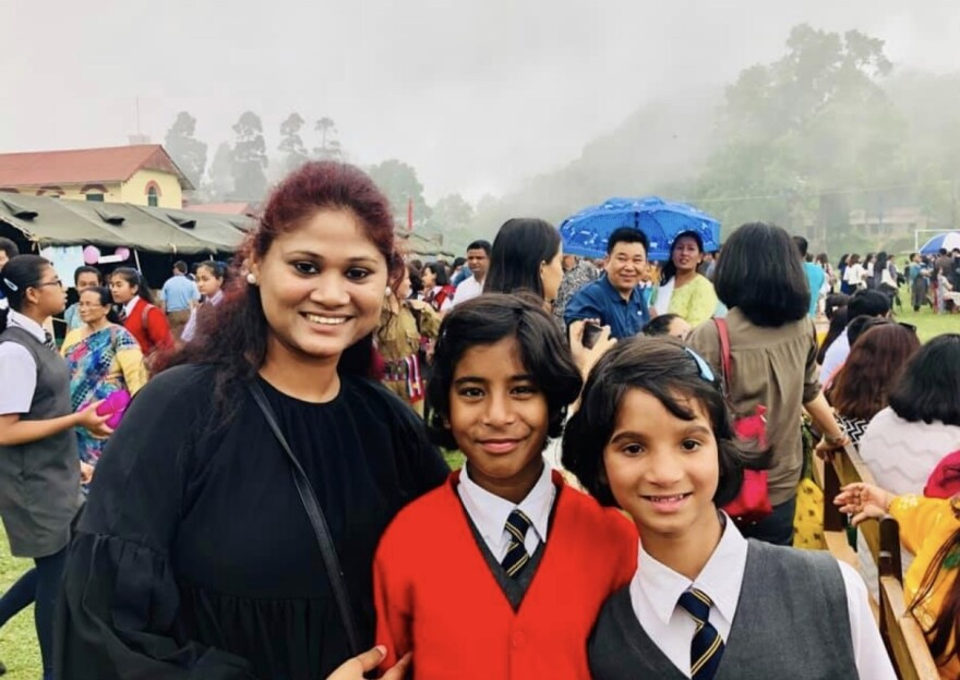Sima Halder, a teacher at New Light, with some of her students.