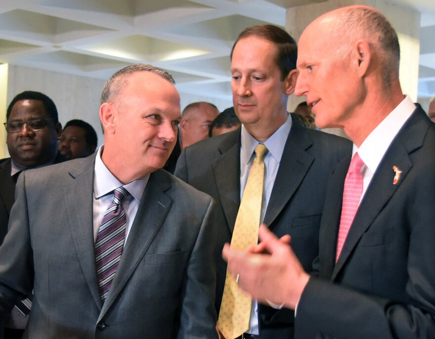 House Speaker Richard Corcoran, left, speaks with Senate President Joe Negron and Gov. Rick Scott after finishing a special legislative session in June. Corcoran and Scott are headed into another session in disagreement over how to fund public schools.