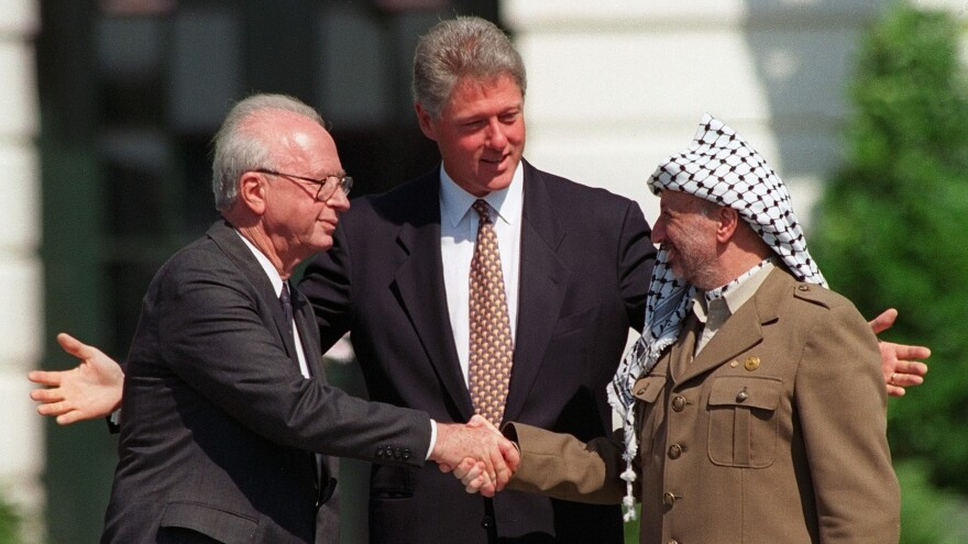 "President Clinton presides over  the 1993 interim peace accord between Israel and the Palestinians on the White House lawn with Israeli Prime Minister Yitzhak Rabin (left) and Palestinian leader Yasser Arafat (right). Years of negotiations followed, but the two sides couldn't reach a deal. Afterward, Clinton was highly critical of Arafat, telling him, ""I am a failure — and you made me one."""
