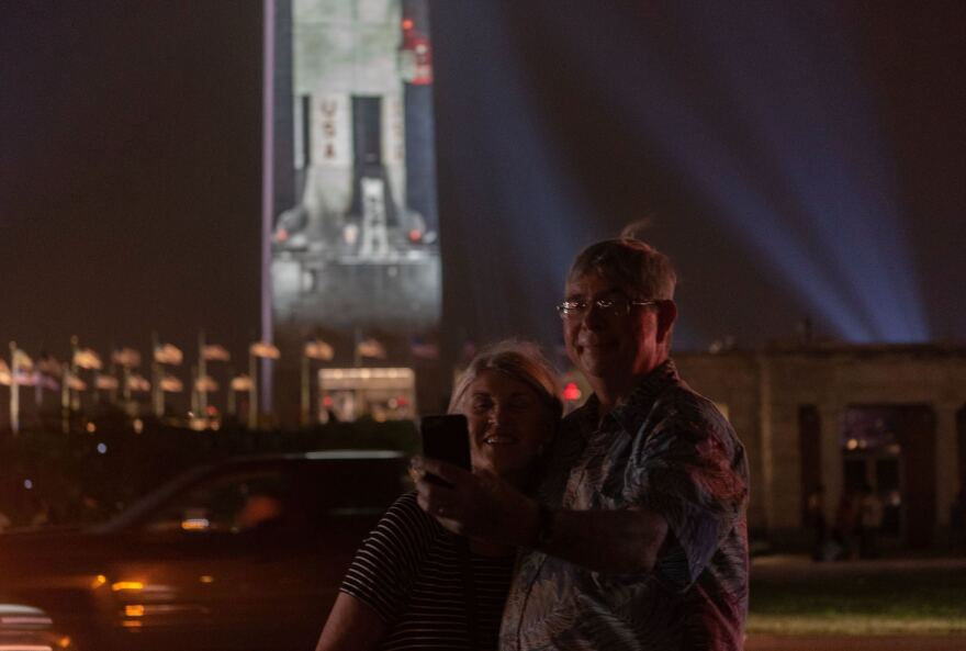 "Sarah and Mark Moser traveled from Oakland, Calif., and were excited to see the projection. ""I remember we watched the launch on TV when we were kids,"" Mark Moser said."