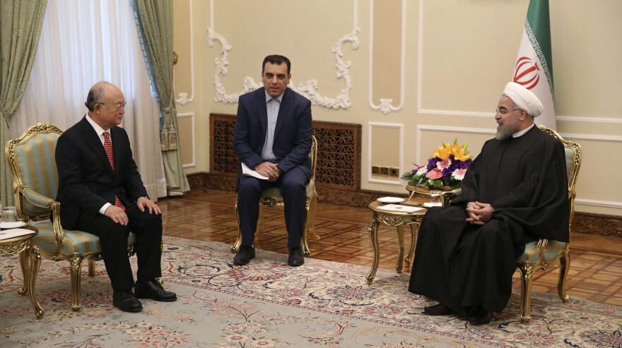 Iranian President Hassan Rouhani (right) meets with U.N. nuclear chief Yukiya Amano (left) and an unidentified interpreter in Tehran, Iran, last month to discuss the country's nuclear program.