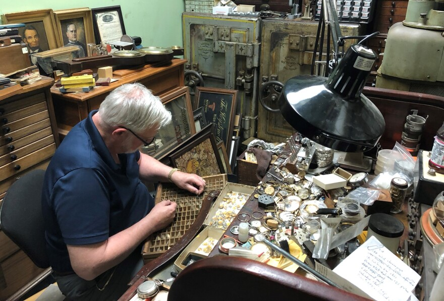 Don Barrett sorts watch crystals at his vintage timepiece shop in Kent.