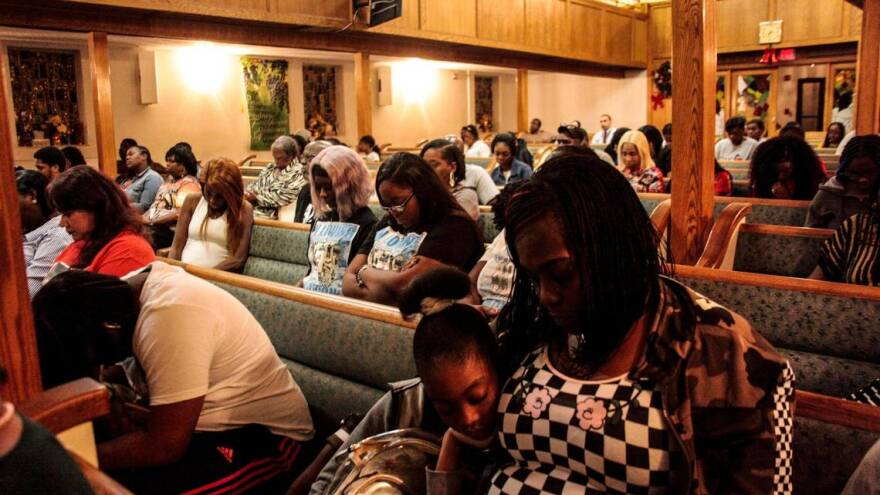 Mourners gathered at Mount Calvary Baptist Church, 1140 NW 62nd St., on New Year's Day to remember loved ones lost to gun violence.