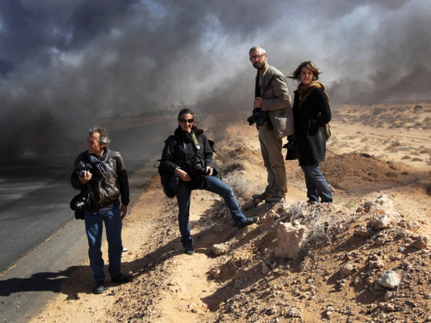<strong>Ras Lanuf, March 11</strong>: Lynsey Addario and Tyler Hicks of <em>The New York Times</em> (center left and right) stand on the side of a road in Libya with Yuri Kosyrev of <em>Time </em>magazine and freelancer Nicki Sobecki. Four days later, Addario and Hicks were taken captive along with <em>Times </em>journalists Anthony Shadid and Stephen Farrell.