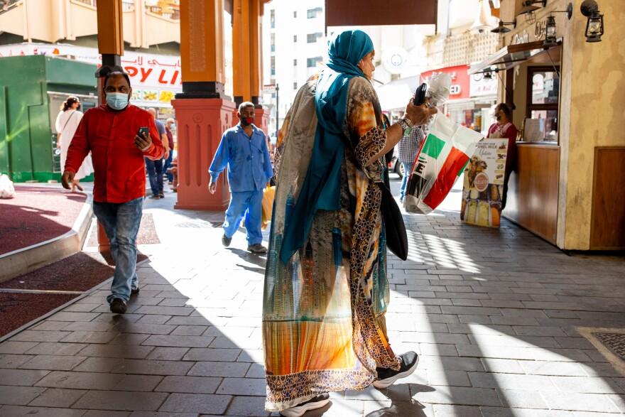 Israeli tour guide Lihi Ziv (center) walks through the Deira district near the Grand Souq in Dubai.