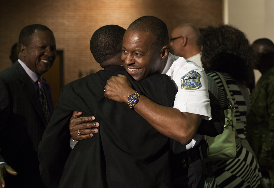 Friends, family and residents congratulate Ferguson Police Chief Delrish Moss at his swearing-in ceremony on Monday.
