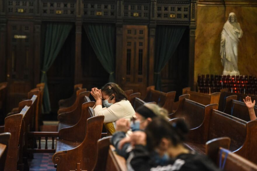 People pray inside of St. Michael's Church on May 26, 2020 in Brooklyn. (Stephanie Keith/Getty Images)