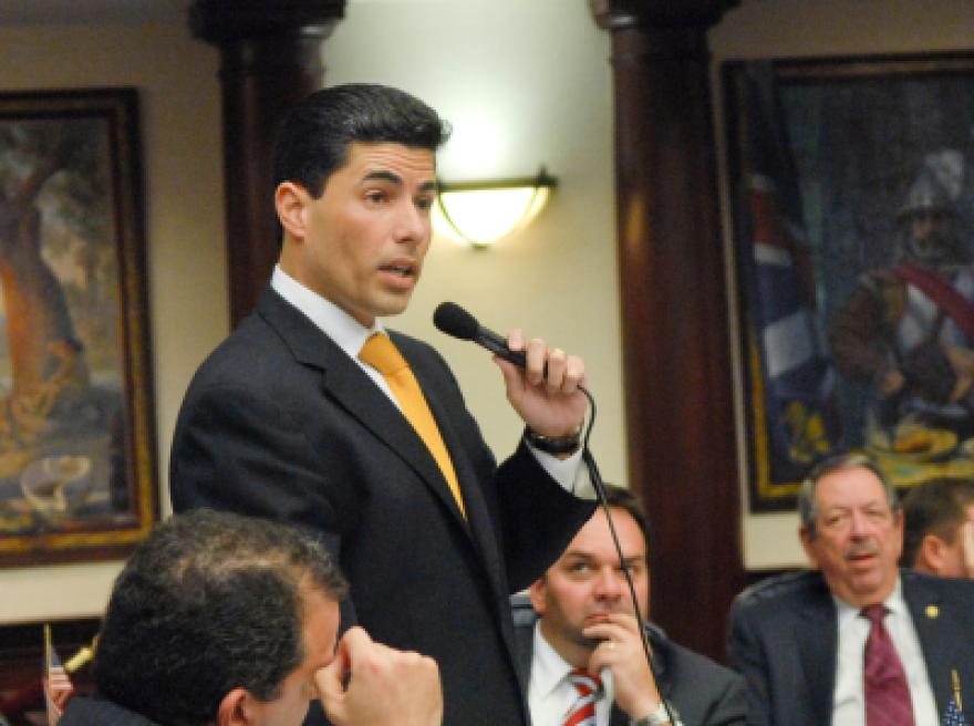House Speaker Jose Oliva, R-Miami Lakes, address a room.