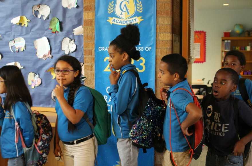 Elementary students line up for their next class at IDEA Carver charter school on San Antonio's East Side May 24, 2019.