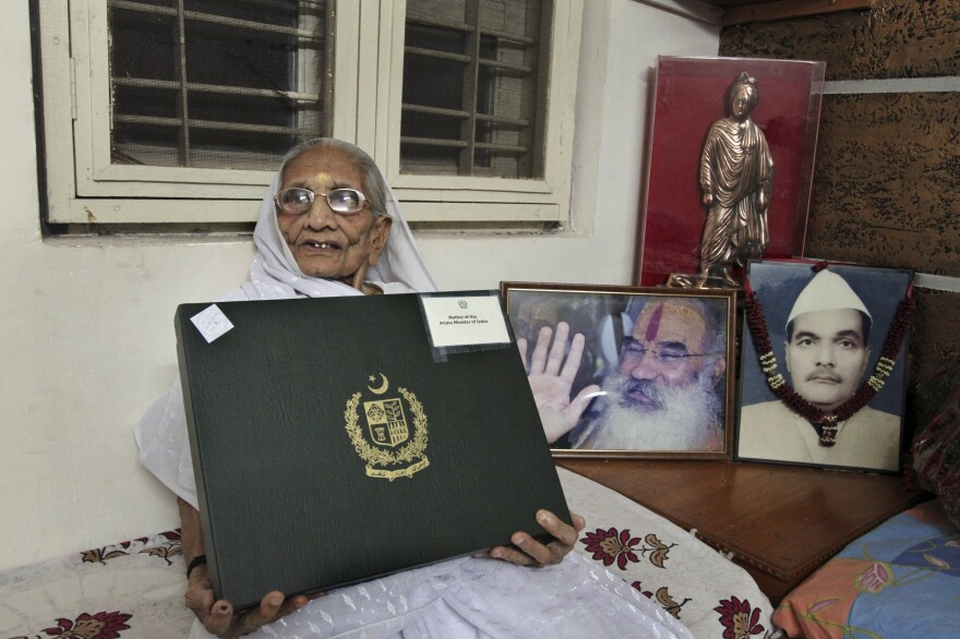 Hiraben, mother of India's Prime Minister Narendra Modi, holds a box with a sari gifted to her by Pakistani Prime Minister Nawaz Sharif on June 5 in Gandhinagar, India. Earlier Modi had gifted a shawl to the Pakistani leader's mother.