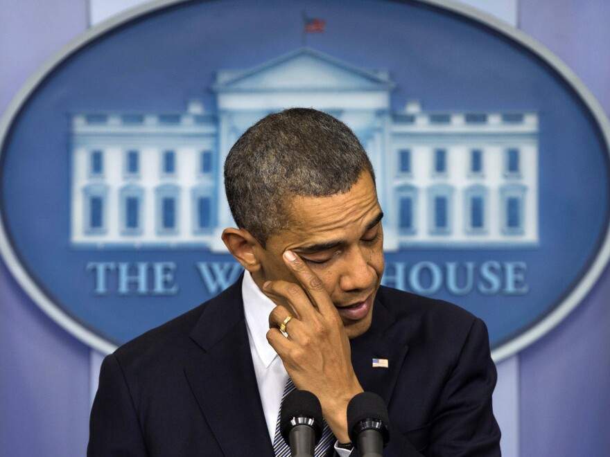 President Obama wipes away tears as he talks about the Connecticut elementary school shooting Dec. 14 in the White House briefing room. Obama was in Colorado on Wednesday and planned to visit Connecticut next week to keep pushing for new gun laws.
