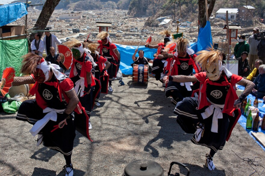 Japanese performers dance at a temple in the tsunami-devastated area of Rikuzentakata, Japan, on April 17.