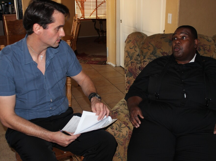 Mercy Care case manager Dave Oxford (left) checks in with his client, Joseph Ford.