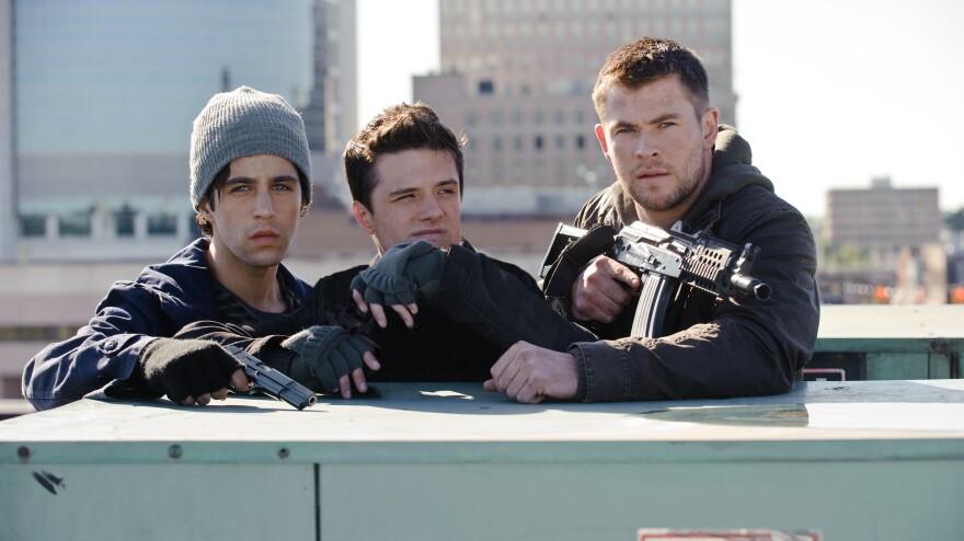 From left: Matt Eckert (Josh Peck) and his friend Robert (Josh Hutcherson) join Matt's Marine brother Jed (Chris Hemsworth) on a mission to stop North Korean invaders.
