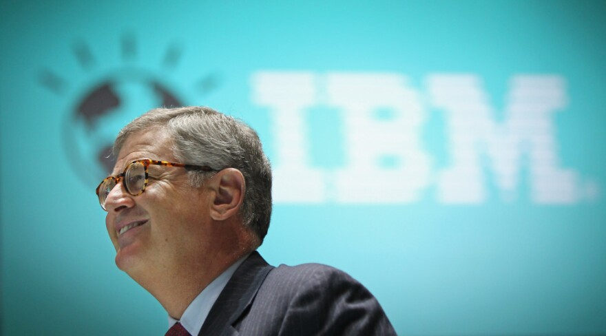 <strong>Reason To Smile:</strong> Samuel Palmisano, president and CEO of IBM, walks by an IBM logo at the CeBIT technology fair in Hanover, Germany. Palmisano is set to step down later this month, and Virginia Rometty will take over on Jan. 1.