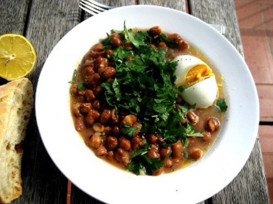"<em>Suhoor </em>tables sometimes feature a dish of <a href=""http://www.saveur.com/article/Recipes/Classic-Stewed-Fava-Beans"">stewed fava beans</a> called ful medames."
