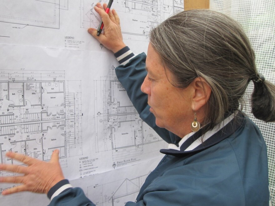 Martha Rose looks over construction blueprints. She refers to herself as a  building nerd and worries about every detail from the overall plan of a  project to how a particular corner will be built. <strong> </strong>