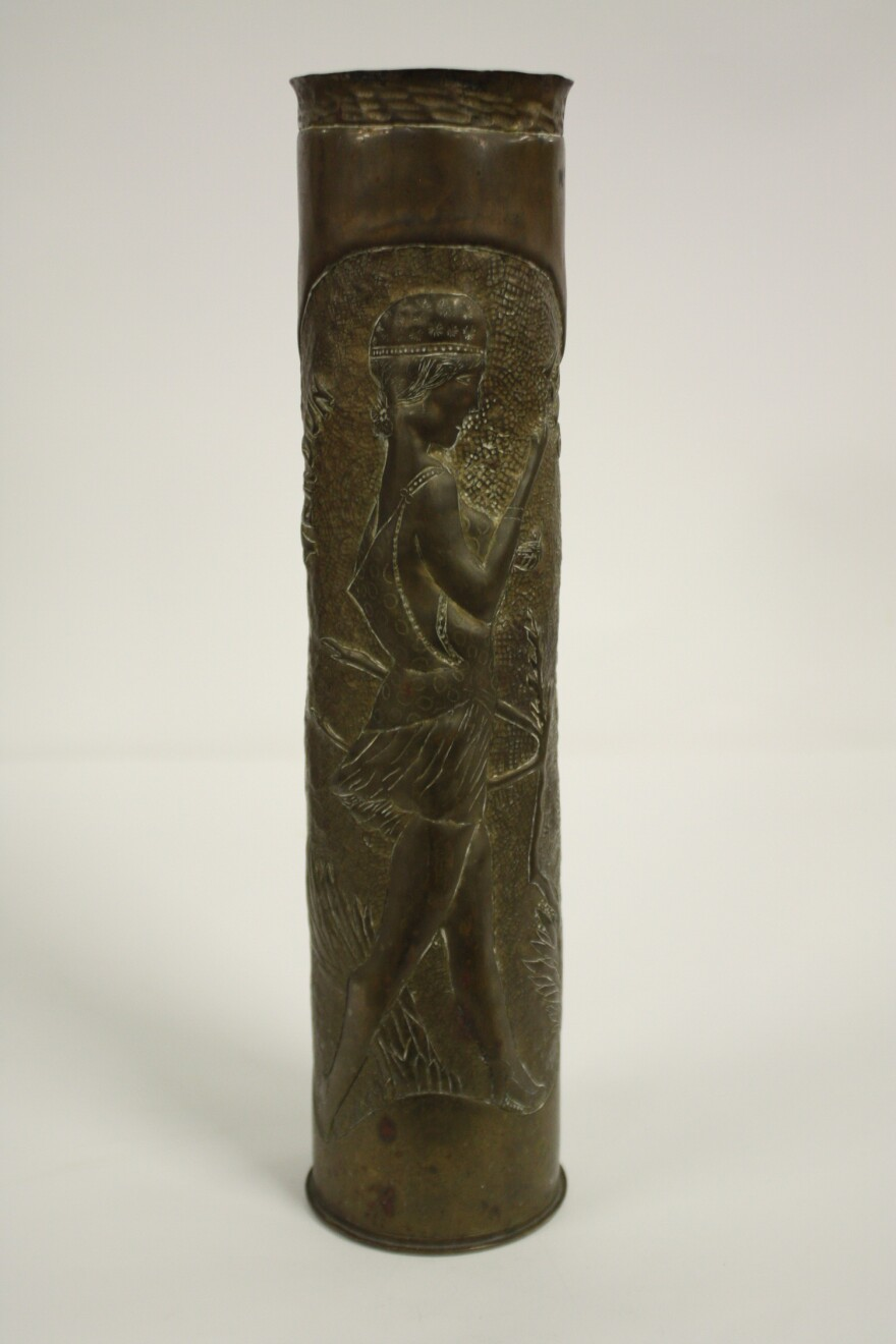 French shell art made of 75mm shell with a stylish French woman decoration and the text of the 1918 Verdun museum collection.
