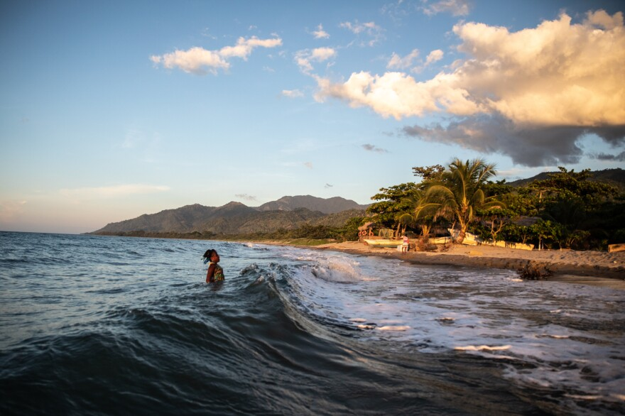 Jirian leaps with the waves behind her family home in Rio Esteban. Even though Ella's two daughters were born and raised in Tegucigalpa's urban mountains, both were quick to take to the water.