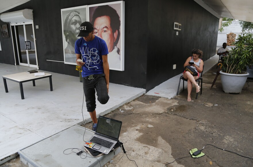 People in Havana use a free Wi-Fi network at a center run by artist Kcho on March 11. It's a small but unprecedented loosening of Cuba's strict Internet regulations by the government. Still, the vast majority of Cubans do not have Internet access.