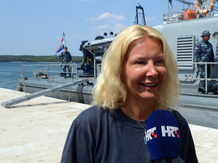 British tourist Kay Longstaff speaks to the media upon her arrival in Pula on a Croatian coast guard ship on Sunday.