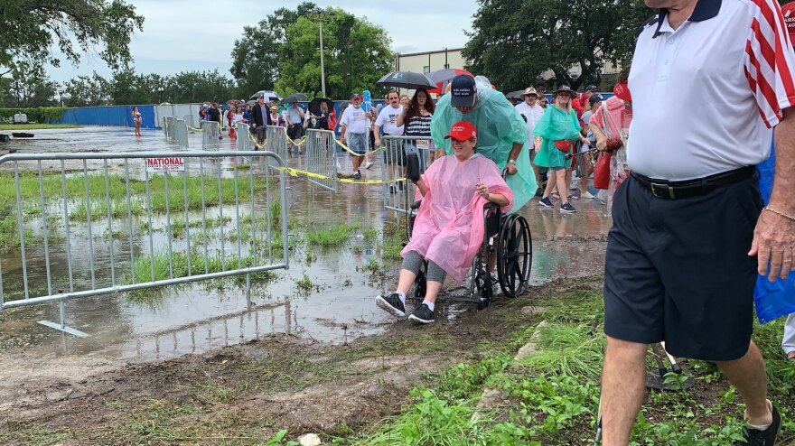 A massive downpour hit as attendees were lining up for President Trump's campaign rally at the Amway Center in Orlando, Fla. It didn't deter many people, but did cause muddy conditions outside the arena.