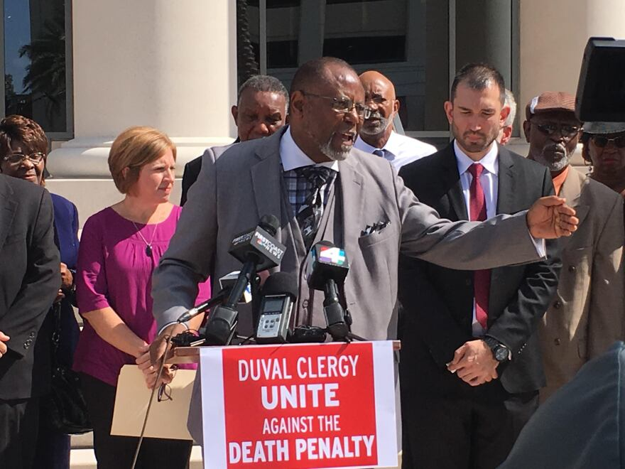 Pastor R.L. Gundy leads a press conference against the death penalty outside the Duval County Courthouse Wednesday.