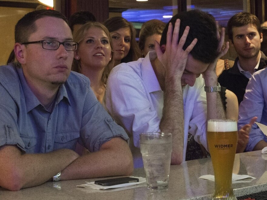 Bar patrons watch the Oct. 3 presidential debate at Bullfeathers, a bar a short distance from the U.S. Capitol. Drinking and debate-watching often go hand in hand — to the point where drinking games have been developed around watching the debates.