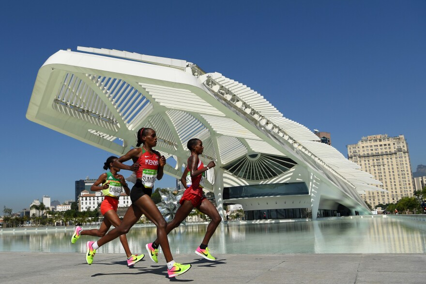 Kenya's Jemima Sumgong  (center) won the women's marathon Sunday in Rio. Bahrain's Eunice Kirwa (right) won silver, while Ethiopia's Mare Dibaba finished third. While Kenyan women have often medaled, Sumgong was the first from her country to win the event.