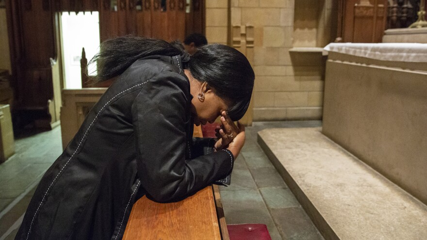 Oneita Thompson prays in the sanctuary of the First United Methodist Church of Germantown. She and her husband, Clive, are from Jamaica and were living in South Jersey since 2004 before receiving deportation orders and seeking sanctuary at the church.