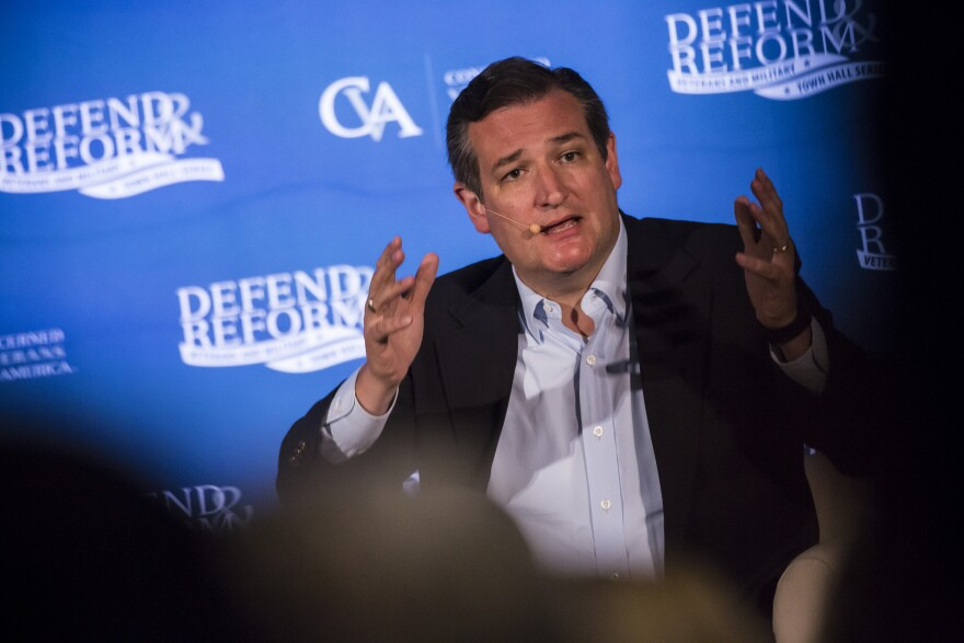 Sen. Ted Cruz talks to members of a town hall in Austin on Thursday about health care.