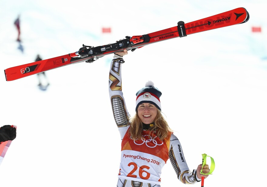 Super-G gold medalist Ester Ledecka of the Czech Republic celebrates her surprise win on Feb. 17. She went on to win gold in parallel giant slalom snowboarding as well, making her the first woman to win two gold medals in different sports at the same Olympic Games.