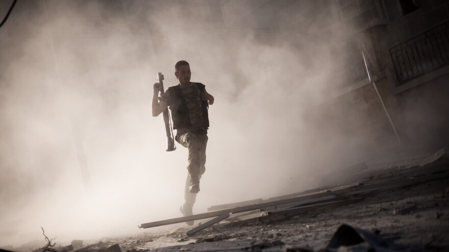 A rebel fighter fled after attacking a tank with a rocket-propelled grenade last week in Aleppo, Syria. The escalating Syrian conflict is among several issues in the Middle East that the next U.S. president must confront.