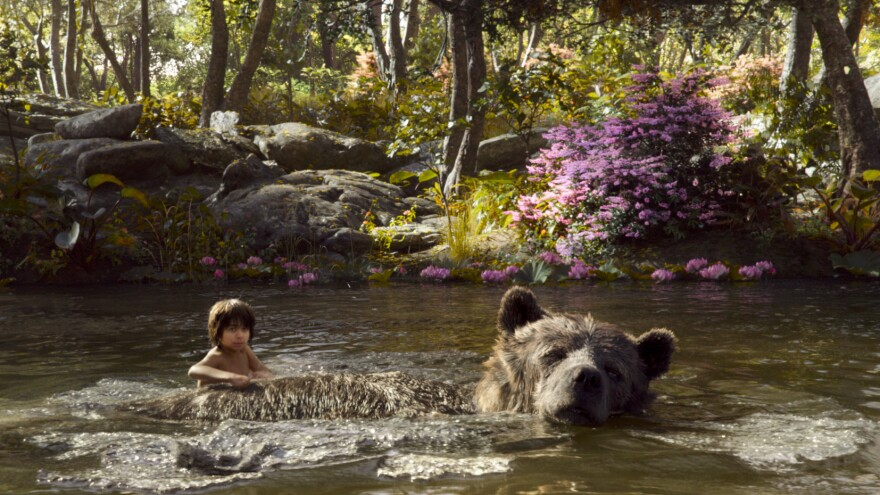 Mowgli and Baloo in <em>The Jungle Book</em>.