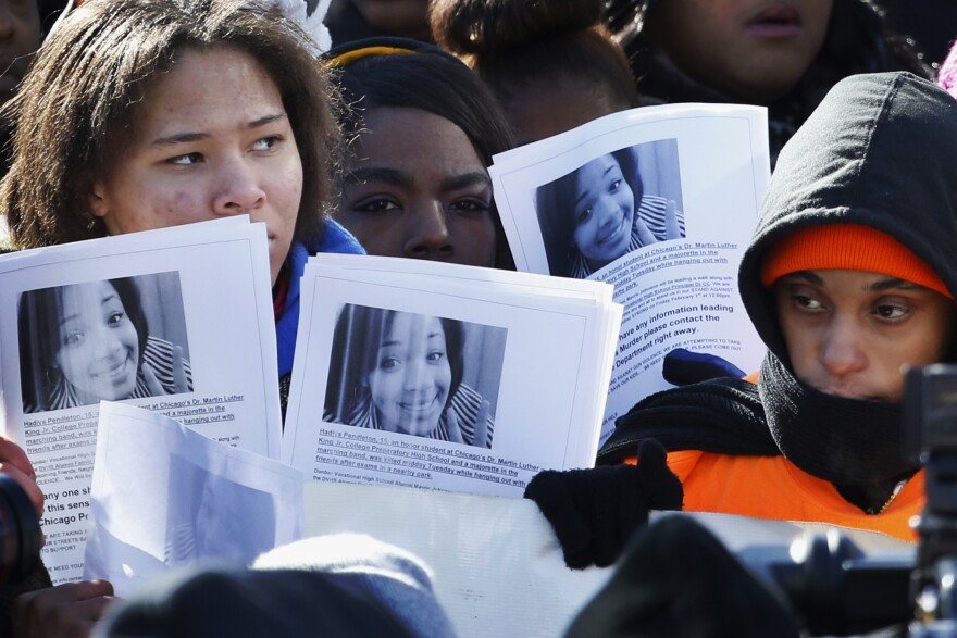 Protesters at an anti-gun violence rally in Chicago in February hold up photos of 15-year-old Hadiya Pendleton at the scene where she was killed Jan. 29. She was shot dead two weeks after she performed at President Obama's second inauguration.