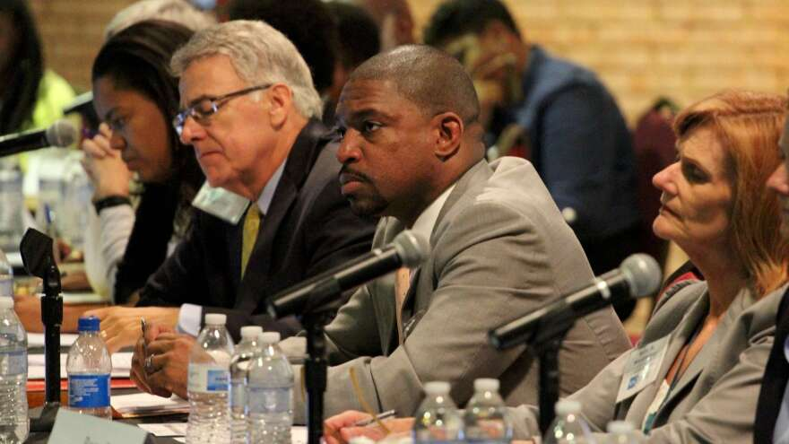 Members of the Ferguson Commission, including co-chairman Starsky Wilson (second from right), listen at a recent hearing. After months of deliberation, the commission is releasing a report laying bare racial and economic inequalities in the St. Louis region, and calling for change.